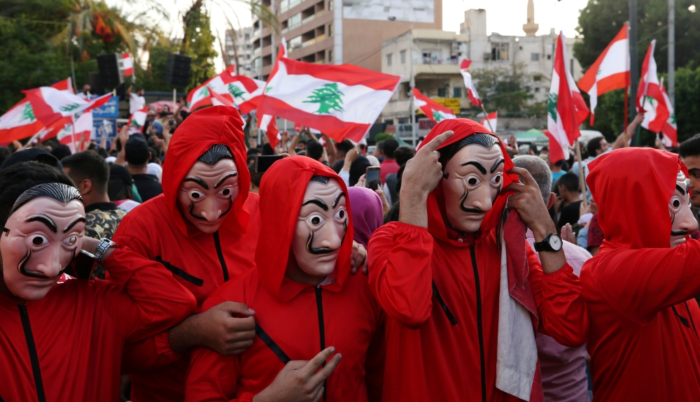 Demonstrators wearing costumes take part in an anti-government protest in the port city of Sidon, Lebanon, Saturday. — Reuters