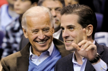 US Vice President Joe Biden and his son Hunter Biden attend an NCAA basketball game between Georgetown University and Duke University in Washington, US, Jan. 30, 2010. — Reuters