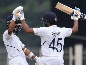India`s Rohit Sharma (R) celebrates his century (100 runs) with teammate Ajinkya Rahane during the first day of the third and final Test match between India and South Africa at the Jharkhand State Cricket Association (JSCA) stadium in Ranchi on Saturday. — AFP