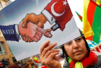 People attend a pro-Kurdish demonstration against Turkey's military action in northeastern Syria in Frankfurt, Germany, on Saturday. — Reuters