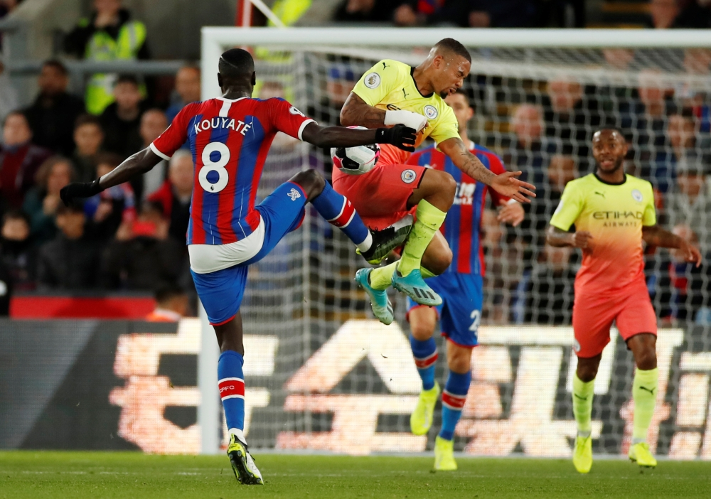 Crystal Palace's Cheikhou Kouyate in action with Manchester City's Gabriel Jesus at Selhurst Park, London, Britain, on Saturday. — Reuters