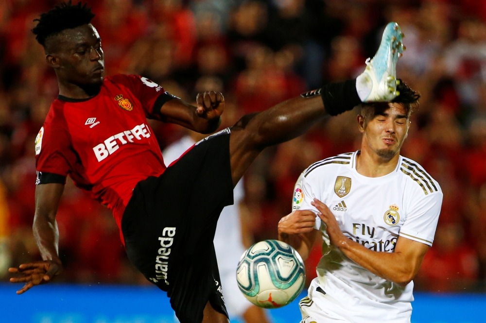 Mallorca's Iddrisu Baba in action with Real Madrid's Brahim Diaz at Iberostar Stadium, Palma, Spain, on Saturday. — Reuters