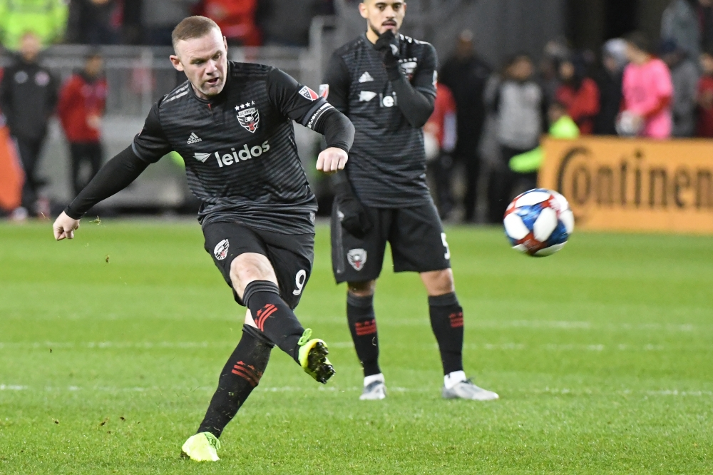 DC United forward Wayne Rooney (9) kicks the ball on net against the Toronto FC in the second half at BMO Field in Toronto, Ontario, Canada, on Saturday. — Reuters