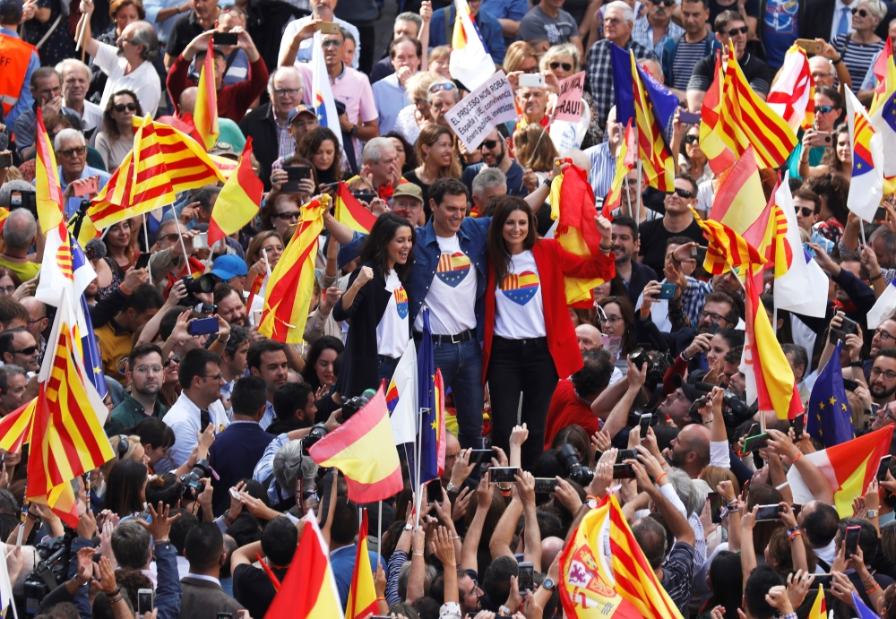Ciudadanos party leaders Albert Rivera, Ines Arrimadas and Lorena Lordan attend a demonstration in support of the unity of Spain at Sant Jaume square outside of Government of Catalonia headquarters in Barcelona, Sunday. — Reuters