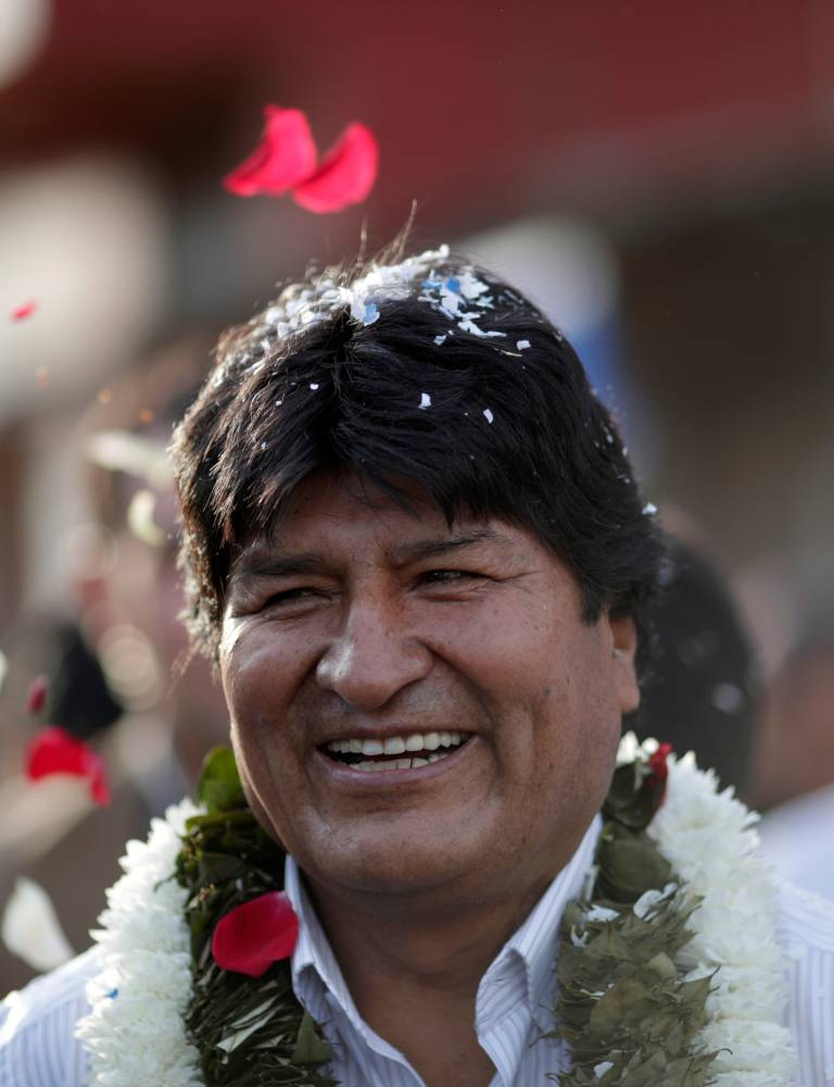 Bolivia's President and candidate Evo Morales of the Movement Toward Socialism (MAS) arrives to vote during the presidential election at a polling station in a school in Villa 14 de Septiembre, in the Chapare region, Sunday. — Reuters