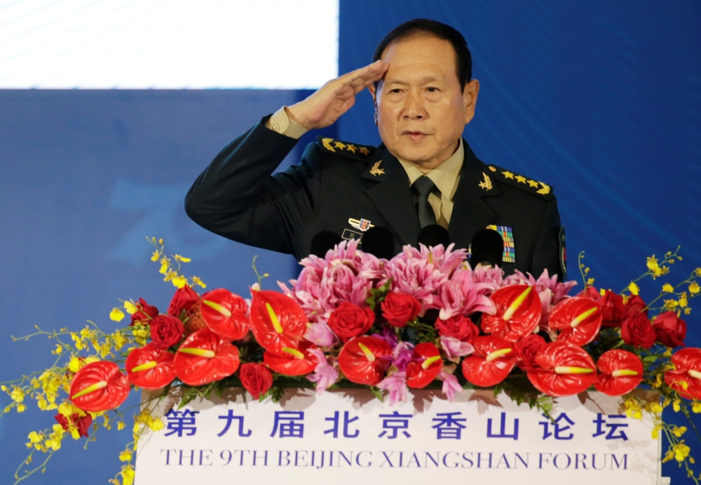 Chinese Defense Minister Wei Fenghe salutes before a speech at the Xiangshan Forum in Beijing, China, on Monday. — Reuters