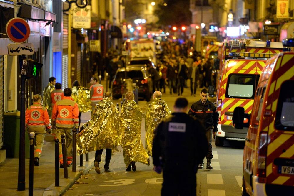 People are being evacuated on rue Oberkampf near the Bataclan concert hall in central Paris in this file photo. — AFP