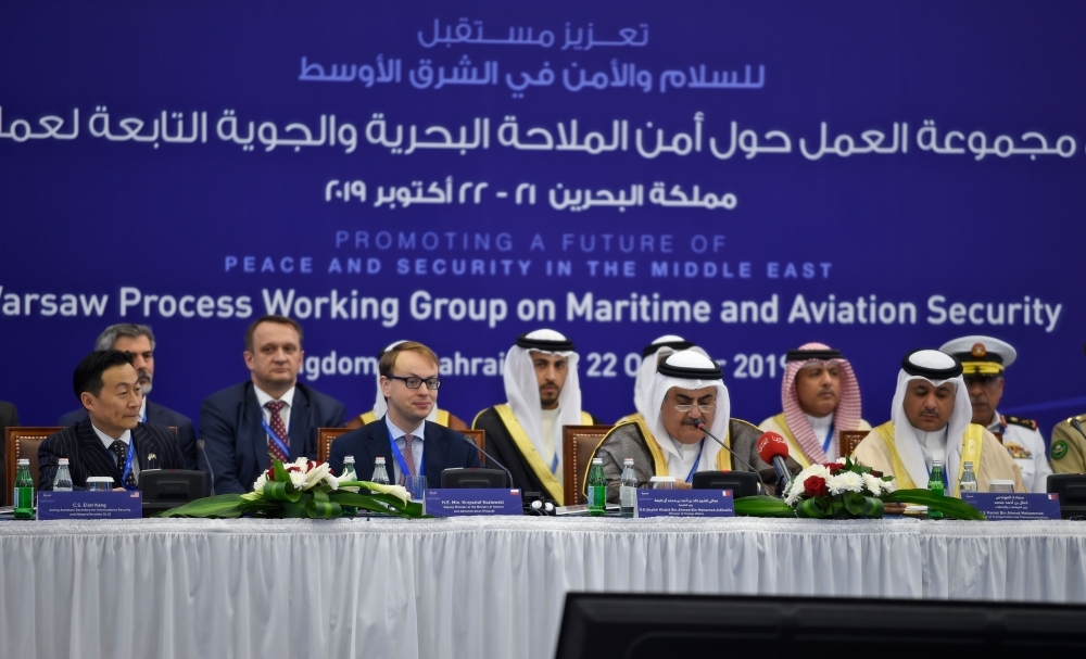 Bahraini Foreign Minister Sheikh Khalid Bin Ahmed Al-Khalifa delivers opening remarks at the start of the two-day Warsaw Ministerial Maritime and Aviation Security Working Group meeting in the Bahraini capital Manama, on Monday, flanked by Poland's deputy Interior Minister Krzysztof Kozlowski, second left, and the representative of the US State Department Eliot Kang, left. — AFP