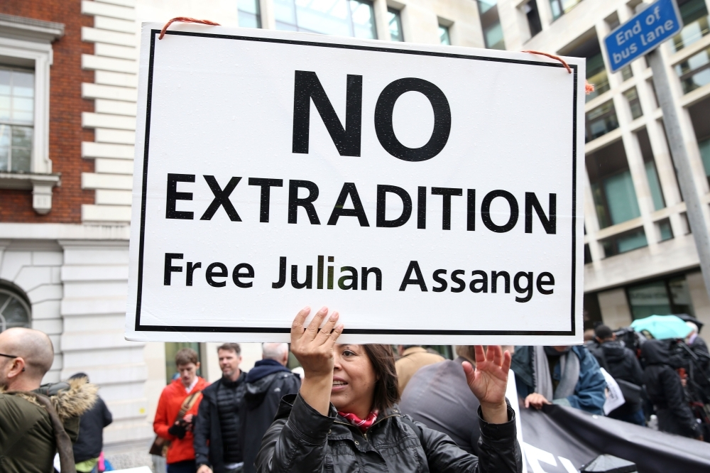 Demonstrators protest outside Westminster Magistrates Court in London on Monday, where WikiLeaks founder Julian Assange has been attending a case management hearing as he fights extradition to the United States. — AFP