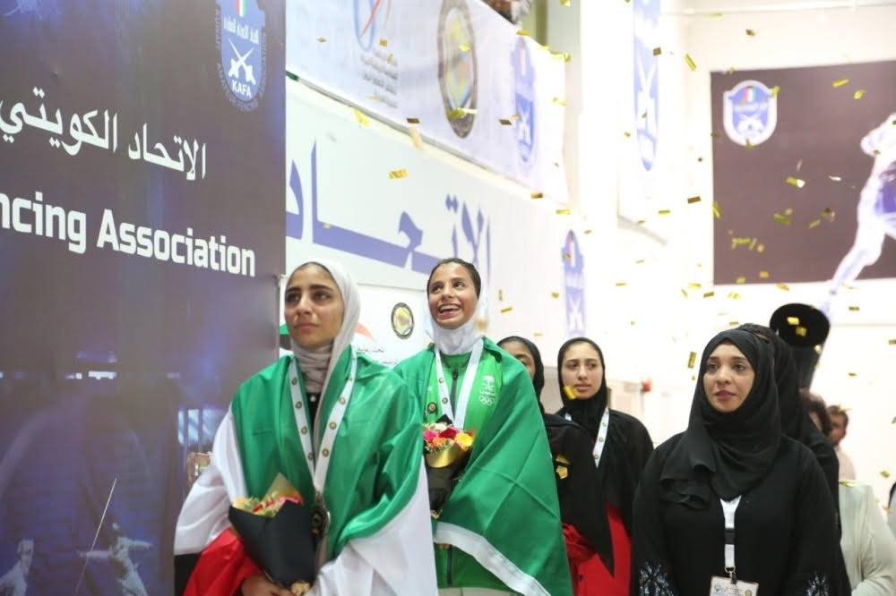 Saudi fencer Hasna Al-Hammad  is seen on the podium after bagging the first Saudi gold medal on the second day of the 6th Gulf Cooperation Council (GCC) Women's Games in Kuwait City on Monday. — SPA
