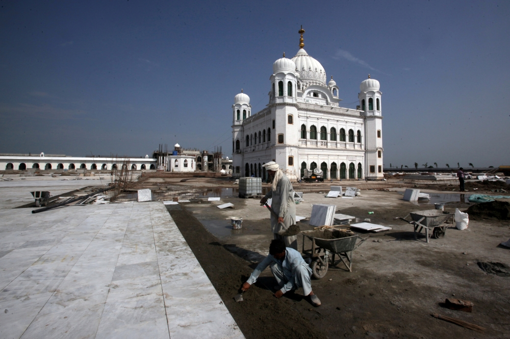 Laborers work at the sites of the Gurdwara Darbar Sahib, which will be open this year for Indian Sikh pilgrims, in Kartarpur, Pakistan, in this Sept. 16, 2019 file photo. — Reuters