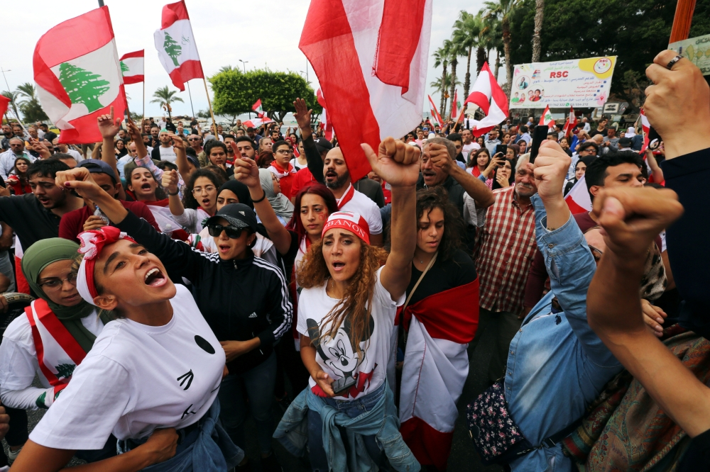 Image result for LEBANON PROTESTS YOUTHS DITCH THEIR DIFFERENCES TO TARGET 'UNJUST' SYSTEM