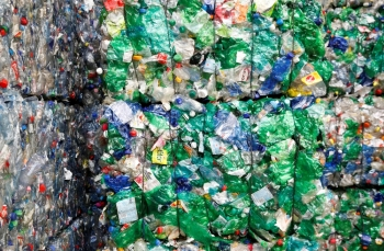 FILE PHOTO: Bundles of pressed PET (polyethylene terephthalate) bottles made out of plastic are seen at the Transcycle Transport & Recycling AG company in Neuenhof, Switzerland, in this Nov. 22, 2018 file photo. — Reuters