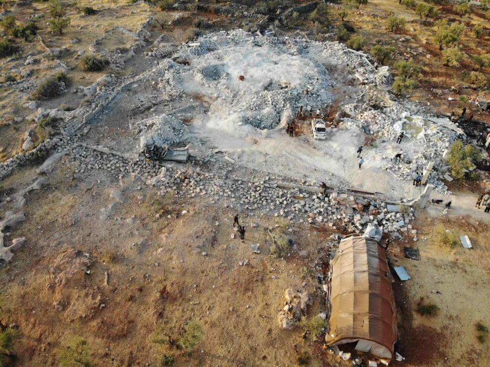 An aerial view taken on Sunday shows the site that was hit by helicopter gunfire which reportedly killed nine people near the northwestern Syrian village of Barisha in the Idlib province along the border with Turkey, where