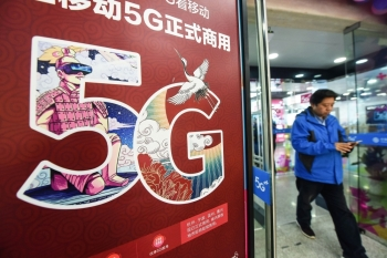 A 5G logo is seen outside a store in Hangzhou in China's eastern Zhejiang province on Thursday. — AFP
