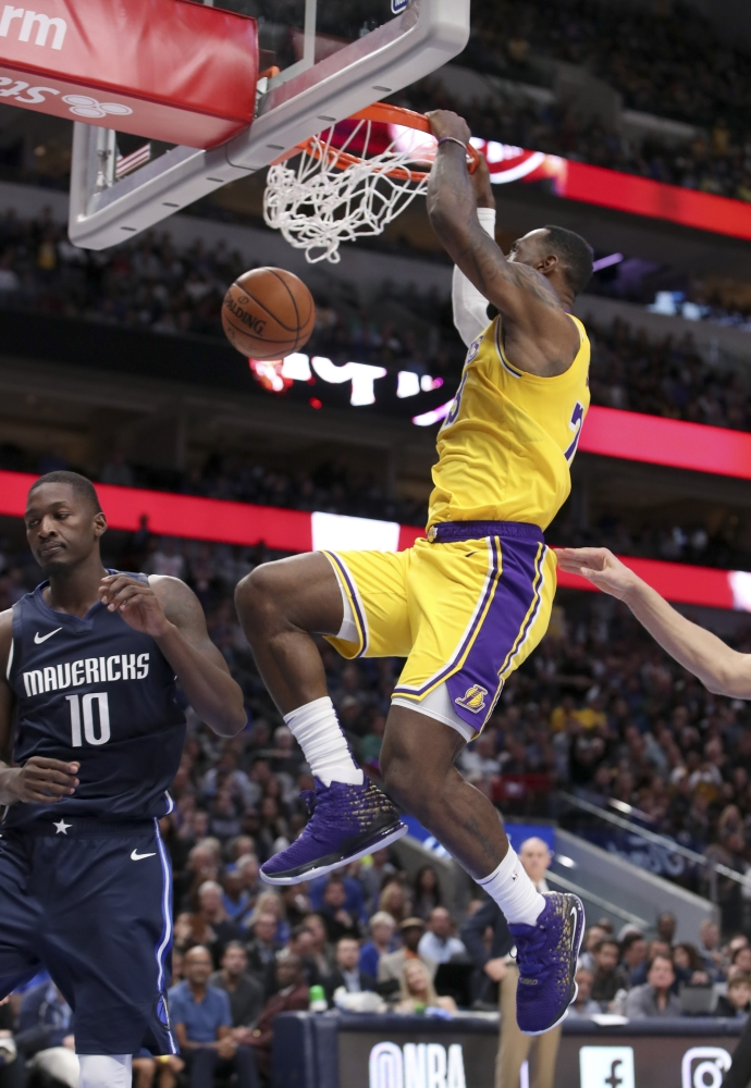 Los Angeles Lakers forward LeBron James (23) dunks during the second half against the Dallas Mavericks at American Airlines Center, Dallas, TX, USA, on Friday. — Reuters