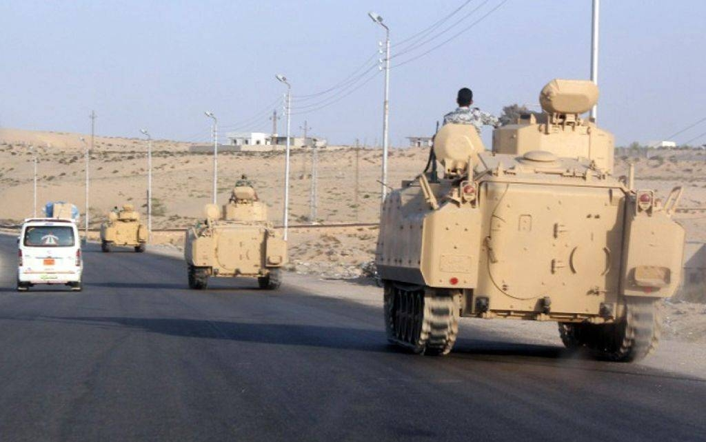 A convoy of Egyptian armored vehicles heads along a road in El-Arish on the Sinai Peninsula, Egypt, in this Aug. 13, 2011 file photo. — AFP