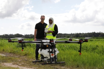 Tanzanian drone pilot Khadijah Abdulla Ali, right, flies a customized DJI Agras MG-1S drone next to DJI's Enterprise Product Manager Eduardo Rodriguez during a training flight as part of a test in using drone technology in the fight against malaria, near Zanzibar City, on the island of Zanzibar, Tanzania, October 31, 2019. Picture taken October 31, 2019. REUTERS/Baz Ratner