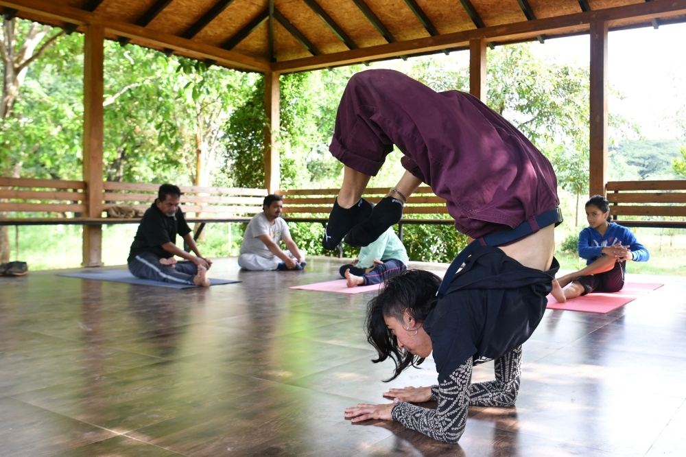 Breakdancer Johanna Rodrigues performs a dance routine as part of her daily practice session at a park in Bangalore, India, in this Oct. 28, 2019 file photo. — FP