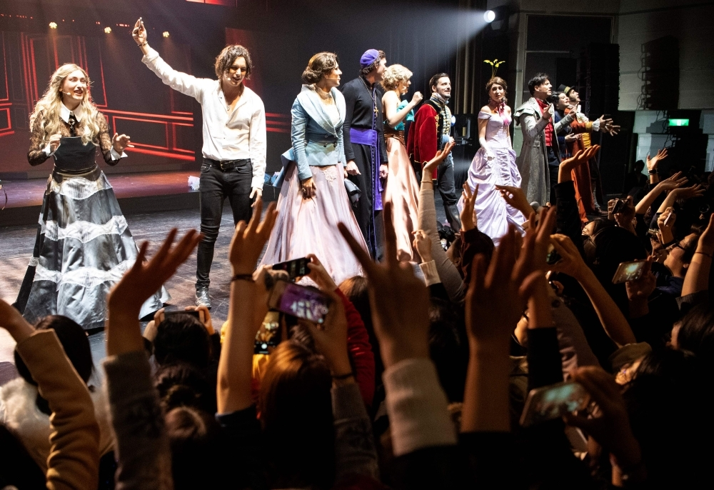 Fans cheer the actors at the end of the French Musical