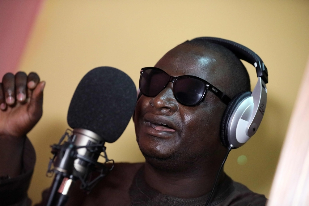 Yahaya Usman, popularly called Yahaya Makaho, a blind singer who rose from being a street beggar to a famously known singer in northern Nigeria, sings while wearing his trademark sunglasses in Kaduna, Nigeria, in this Sept. 25, 2019 file photo. — AFP