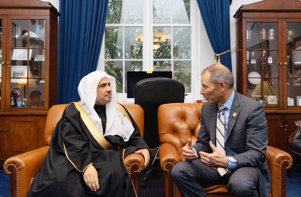 Secretary General of the Muslim World League (MWL) Sheikh Mohammed Al-Issa holds talks with a Congressman John Curtis.