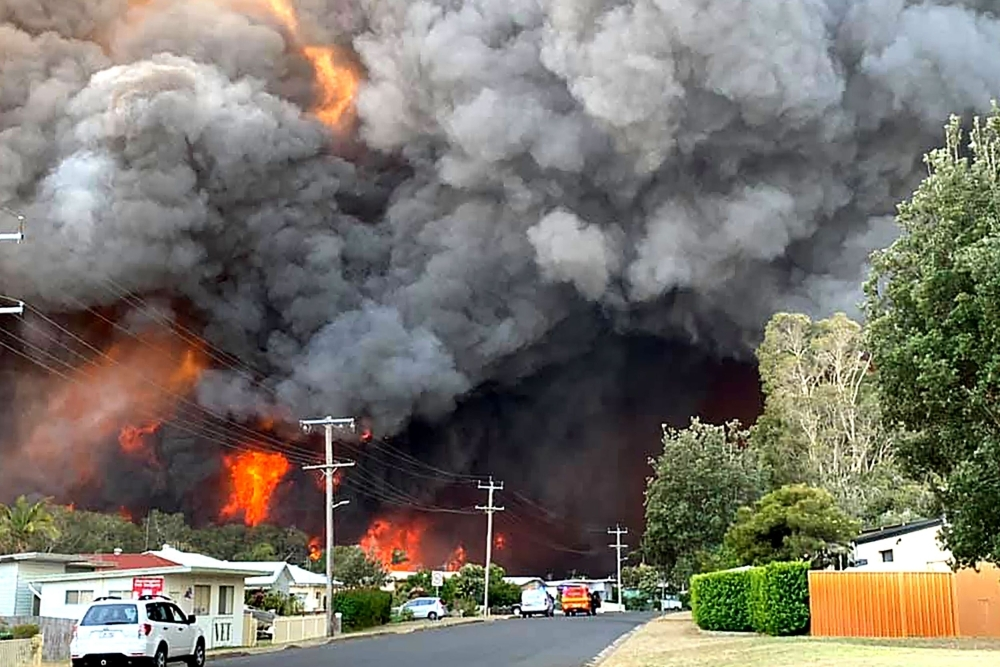 Dozens of out of control bushfires ravage massive areas in Australia