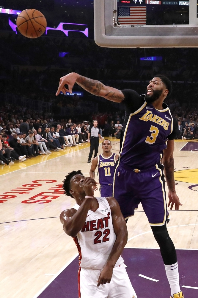 Anthony Davis (3) of the Los Angeles Lakers blocks a shot by Jimmy Butler (22) of the Miami Heat during the second half of a game at Staples Center in Los Angeles, California on Friday.  — AFP