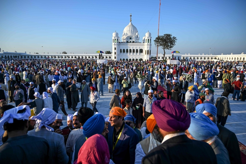 Sikh pilgrims visit the Shrine of Baba Guru Nanak Dev at Gurdwara Darbar Sahib in Kartarpur, near the Indian border, on Saturday. Hundreds of Indian Sikhs made a historic pilgrimage to Pakistan, crossing through a white gate to reach one of their religion's holiest sites, after a landmark deal between the two countries separated by the 1947 partition of the subcontinent. — AFP