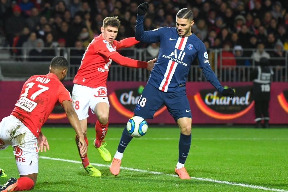 Paris Saint-Germain's Argentine forward Mauro Icardi (R) vies with Brest's players before scoring a goal during the French L1 football match between Stade Brestois 29 and Paris Saint-Germain in Brest, western France on Saturday. — AFP
