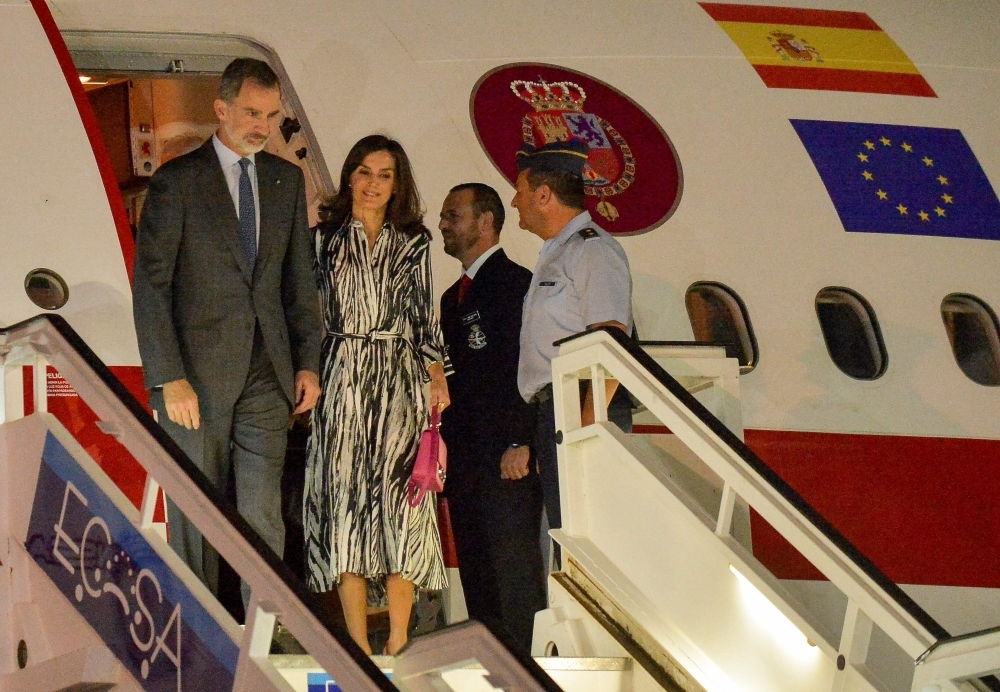 Spanish King Felipe VI (L) and Queen Letizia arrive at Havana's Jose Marti International Airport on Monday. -AFP