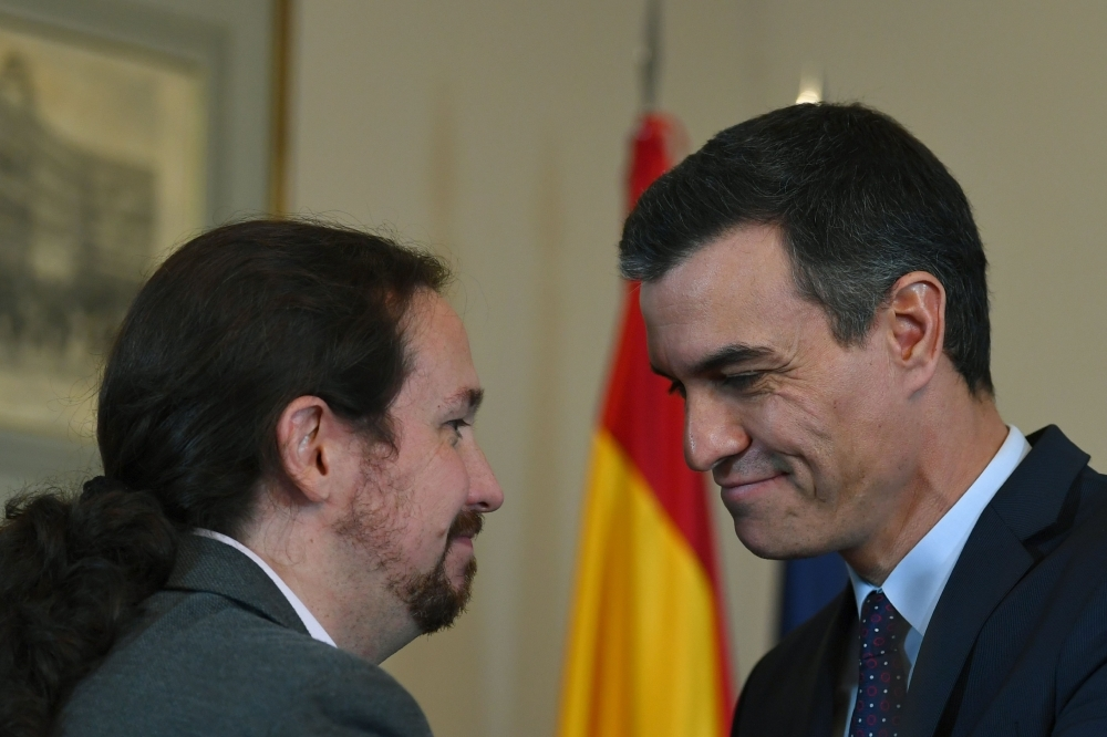 Spanish incumbent prime minister Pedro Sanchez, right, and the leader of the left-wing electoral alliance