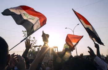 Iraqis demonstrate outside the Basra Governorate's building on Monday in the southern city of Basra. -AFP