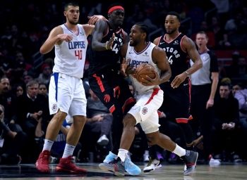 Kawhi Leonard (2) of the LA Clippers bumps into Pascal Siakam (43) of the Toronto Raptors as he drives to the basket as Ivica Zubac (40) and Norman Powell (24) look on during a 98-88 Clippers win at Staples Center in Los Angeles, California on Monday.  — AFP