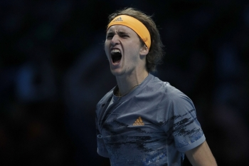 Germany's Alexander Zverev celebrates winning against Spain's Rafael Nadal during their men's singles round-robin match on day two of the ATP World Tour Finals tennis tournament at the O2 Arena in London on Monday. Zverev won 6-2 6-4. — AFP