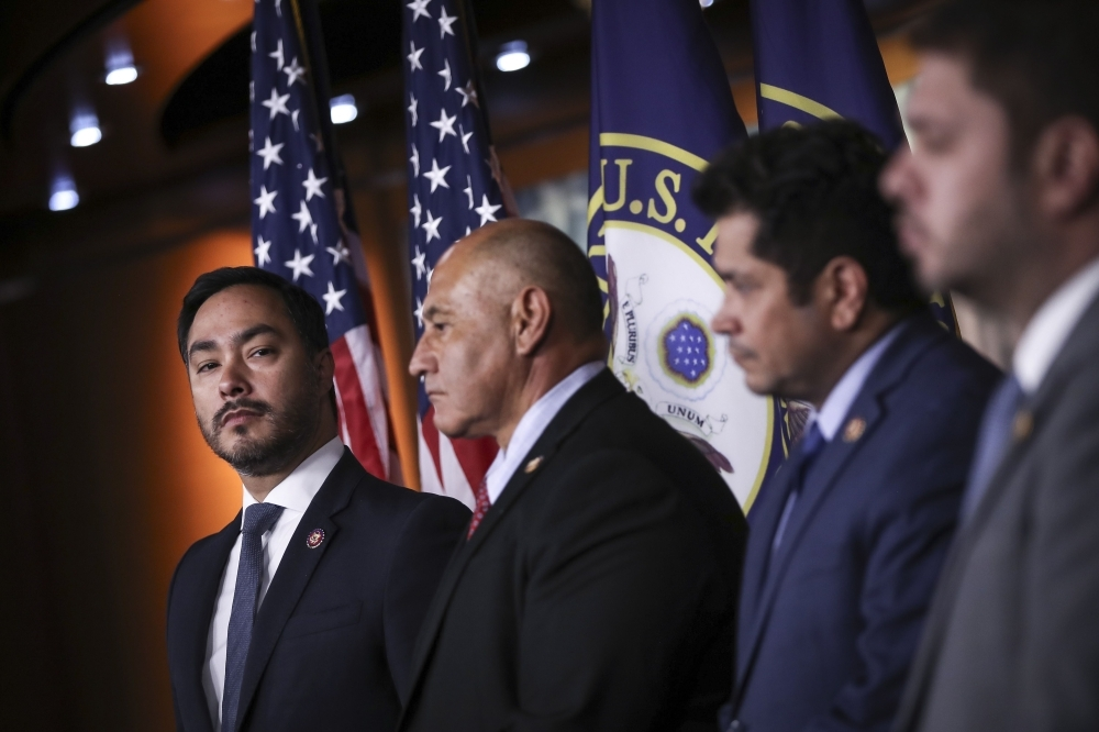At left, Congressional Hispanic Caucus chairman Rep. Joaquin Castro (D-TX) looks on during a news conference to discuss the Supreme Court case involving Deferred Action for Childhood Arrivals (DACA) at the U.S. Capitol on Tuesday in Washington, DC. -AFP
