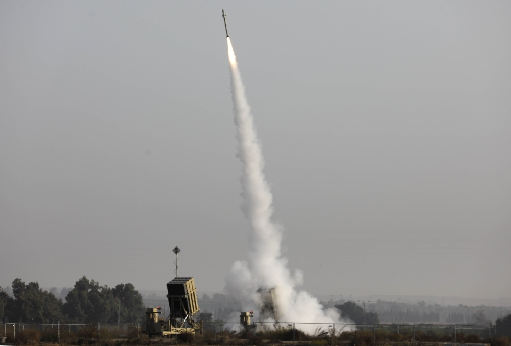 An Israeli missile launched from the Iron Dome defense missile system, designed to intercept and destroy incoming short-range rockets and artillery shells, is pictured in the southern Israeli city of Sderot on Tuesday. -AFP