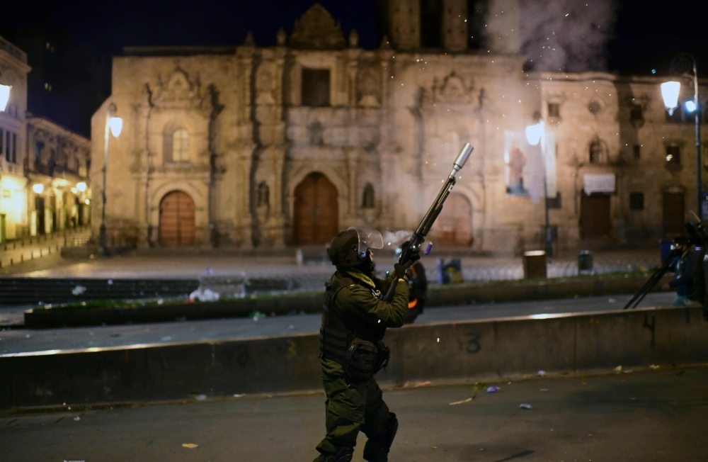 Security forces confront pro-Evo Morales supporters in La Paz, on Tuesday after Jeanine Anez, a deputy speaker of the senate, proclaimed herself Bolivia's new interim president during a session of Congress that failed to reach a quorum. -AFP