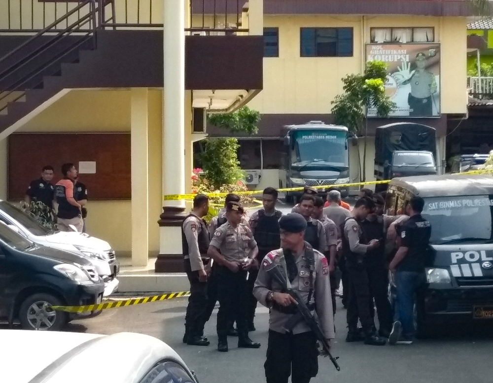 Indonesian police secure their headquarters in Medan, North Sumatra, on Wednesday, after a suicide attack occurred during their morning roll call. -AFP