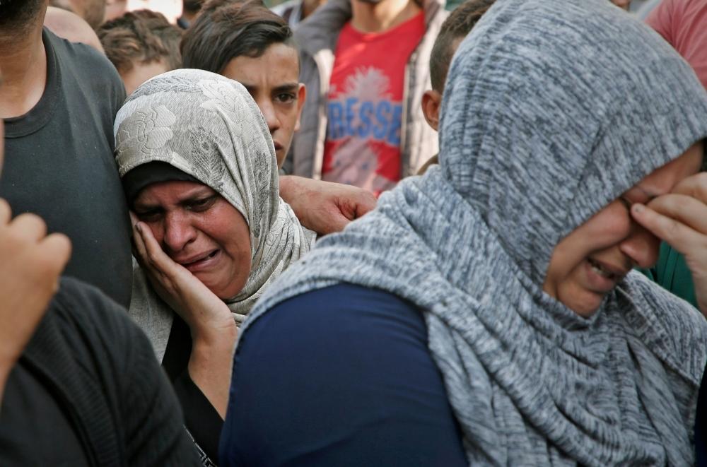 Palestinian women mourn outside the mortuary of Gaza City's Al-Shifa hospital on Wednesday.  — AFP