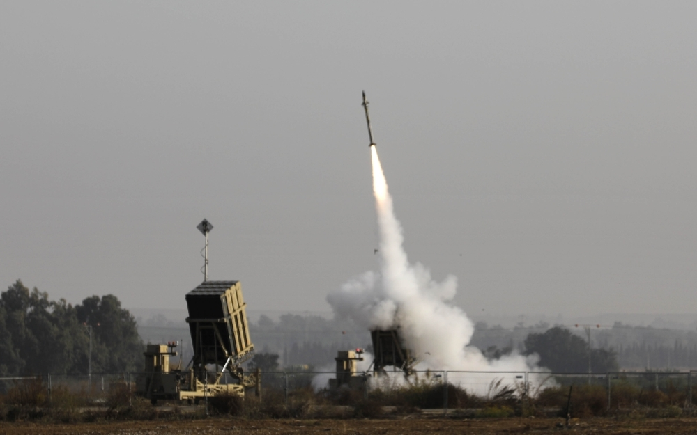 An Israeli missile launched from the Iron Dome defense missile system, designed to intercept and destroy incoming short-range rockets and artillery shells, is pictured in the southern Israeli city of Sderot, on Tuesday. — AFP