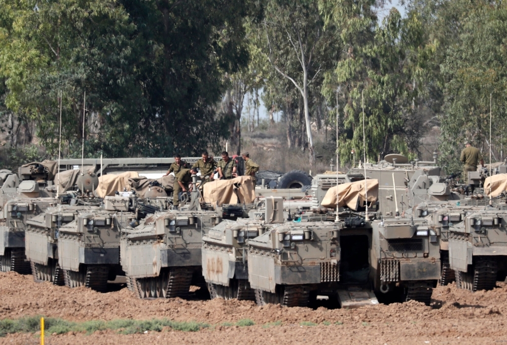 Israeli armored vehicles are pictured stationed near the border with the Gaza Strip on Wednesday. — AFP