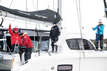 Swedish climate activist Greta Thunberg, center, stands aboard the catamaran La Vagabonde with her father Svante Thunberg, left, La Vagabonde owner Riley Whitelum, second left, and sailor Nikki Henderson, right, as they set sail to Europe in Hampton, Virginia, on Wednesday. — AFP