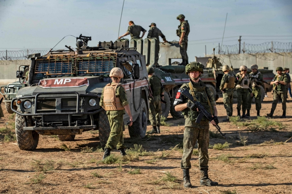 Russian military police take part in a joint Turkish-Russian army patrol near the town of Darbasiyah in Syria's northeastern Hasakeh province along the Syria-Turkey border in this Nov. 11, 2019 file photo. — AFP