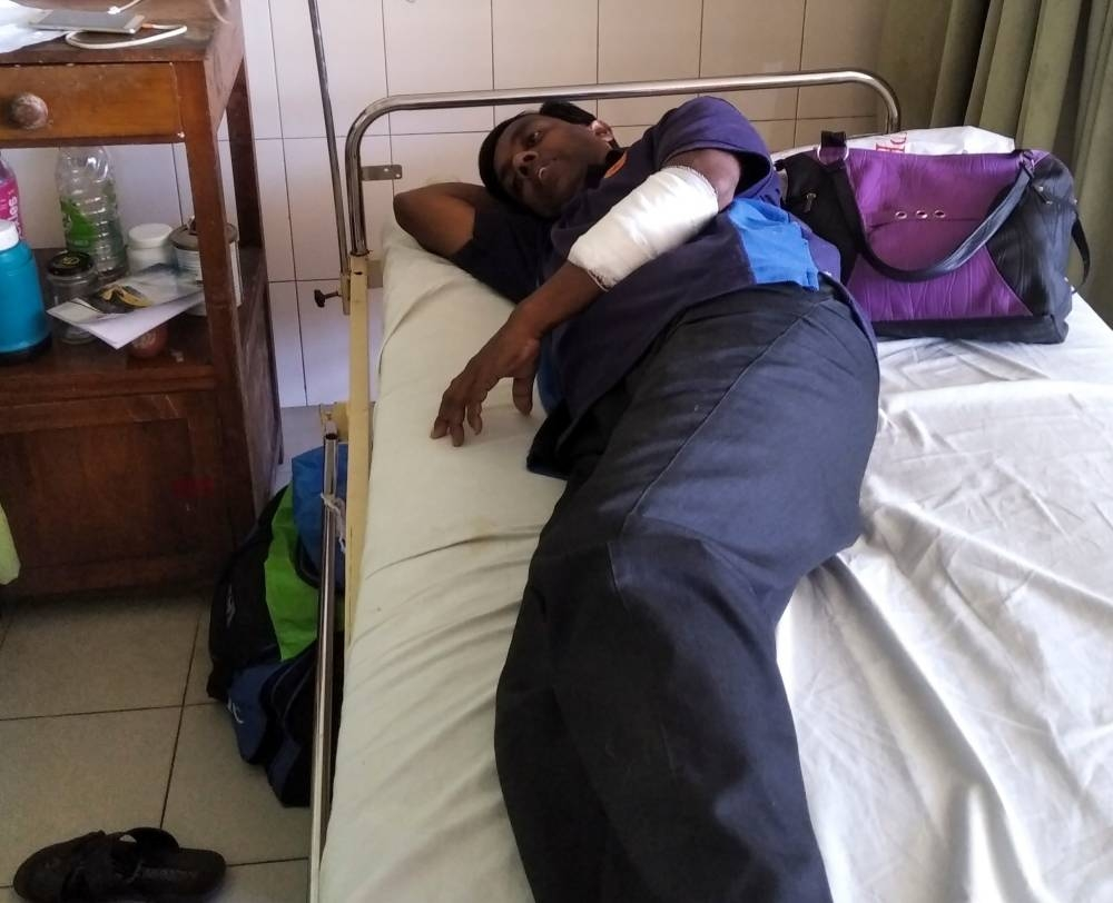 Sri Lankan writer Lasantha Wijeratne receives treatment in a hospital in Galle on Thursda, after being stabbed by armed men. — AFP