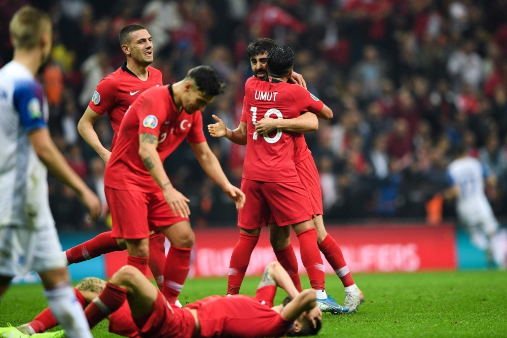 Turkey's team players celebrate after winning the UEFA Euro 2020 qualifying Group H group match between Turkey and Iceland at Turk Telekom Stadium in Istanbul, on Thursday. — AFP