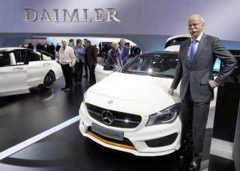 Dieter Zetsche, ex-CEO of German auto giant Daimler AG, poses next to a CLA-Shooting-Brake car prior to his company's annual general meeting, in Berlin, in this April 1, 2015 file photo. — AFP