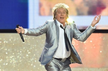 Rod Stewart rocks out on stage at the opening ceremony of the 2014 Glasgow Commonwealth Games at Celtic Park in this file photo. — AFP