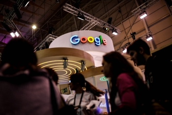 People pass by Google stand during the Web Summit in Lisbon, Portugal, in this Nov. 6, 2019 file photo. — AFP