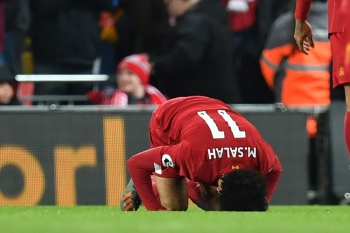 Liverpool's Egyptian midfielder Mohamed Salah celebrates after scoring their second goal during the English Premier League football match against Manchester City at Anfield in Liverpool, northwest England on Nov. 10, 2019. — AFP